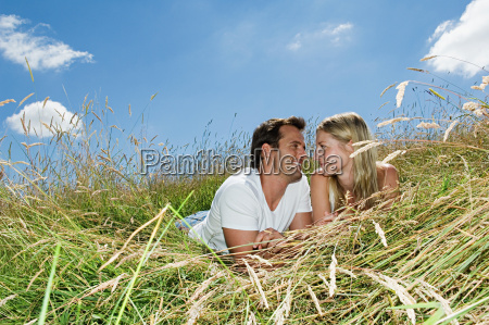 couple lying in a field