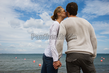 romantic couple by the sea