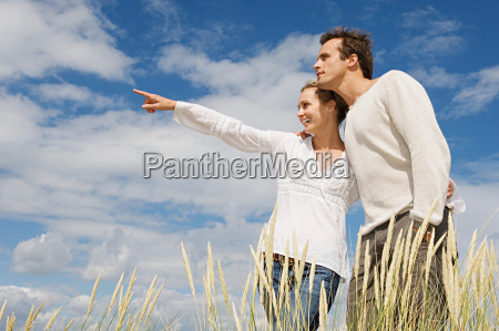 young couple in marram grass field