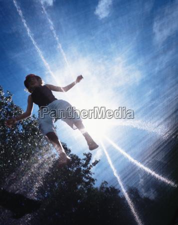 girl jumping in sunlight