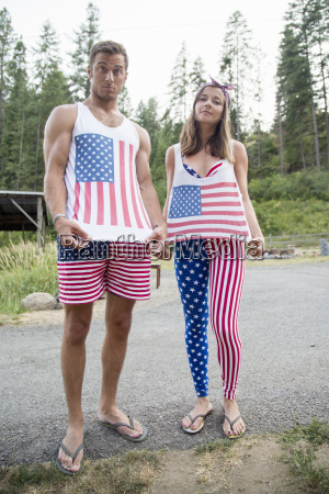 portrait of couple showing off american
