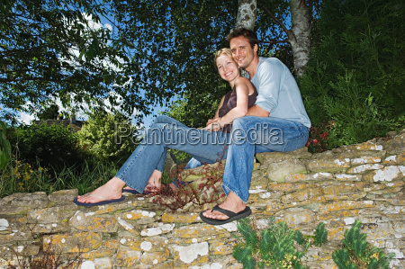 couple on a stone wall