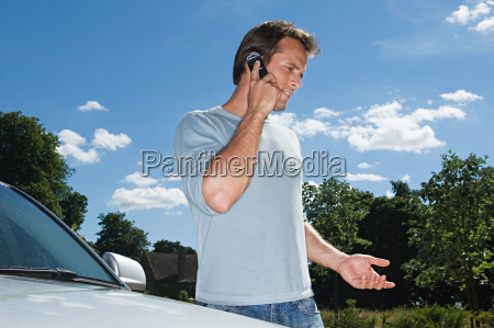 man on mobile phone by his