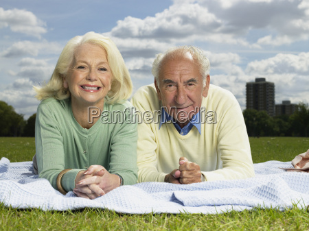 elderly couple resting in a park