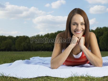 woman lying in a field