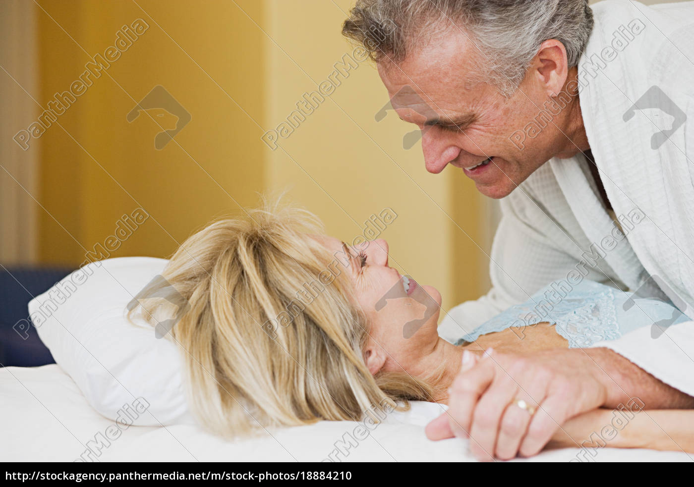 mature, couple, on, bed - 18884210