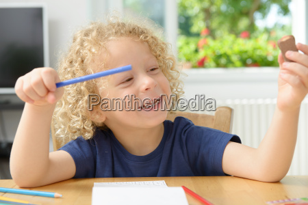 little blond boy drawing in his