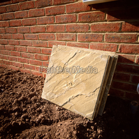 slabs leaning against a brick wall