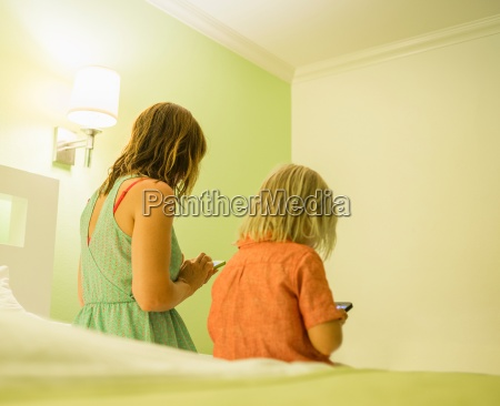 mother and son using smartphone on
