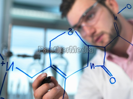 young male scientist illustrating antibiotic chemical