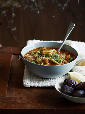 harira soup in bowl with dates