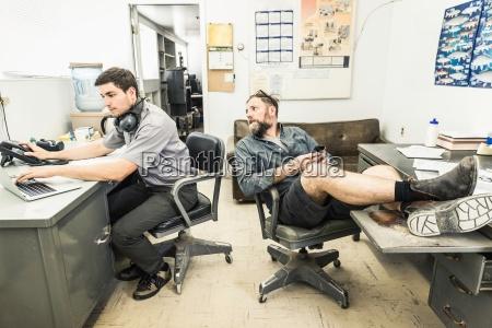 scientists working at desks in plant
