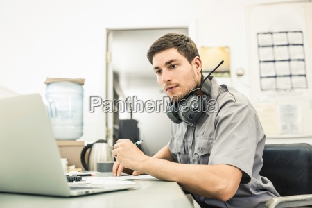 scientist using laptop in plant growth