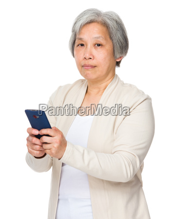 asian senior female with mobile phone