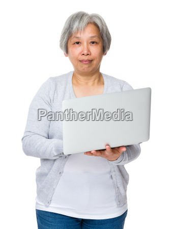 old woman use of the notebook