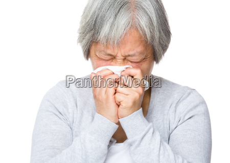 senior woman with nose allergy