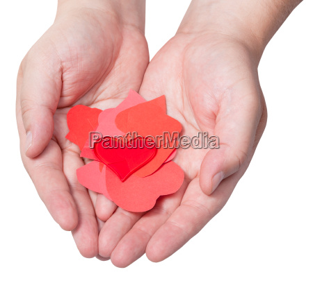 red heart above pile of paper
