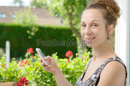 young woman uses a mobile phone