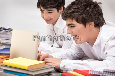 happy schoolboys studying