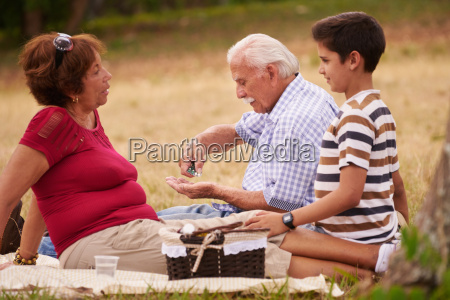 old man grandpa with family taking