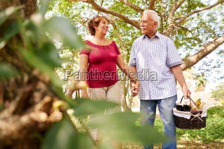 old man woman senior couple walking