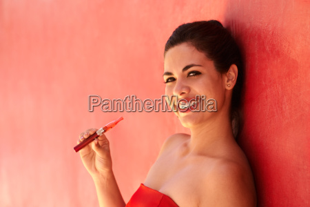 portrait girl smiles electronic cigarette e