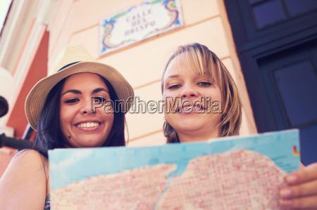 women travelling in havana cuba reading