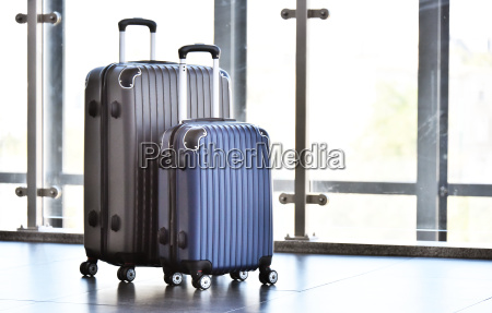 two plastic travel suitcases in the