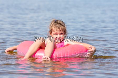 five year girl swims in the