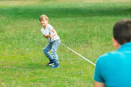 kid playing tug of war