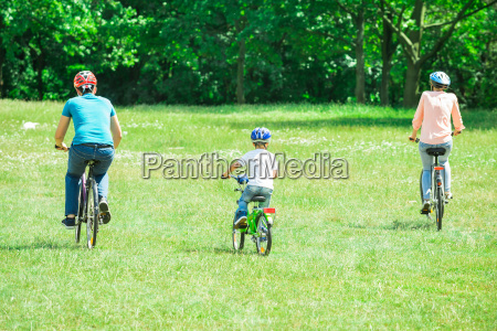 family riding the bicycle in the