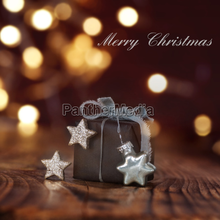 christmas gift in front of festive
