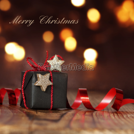 christmas package with red ribbon