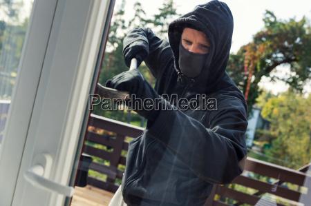 house robbery burglar opens balcony