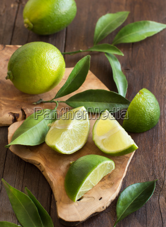 fresh limes with leaves on a