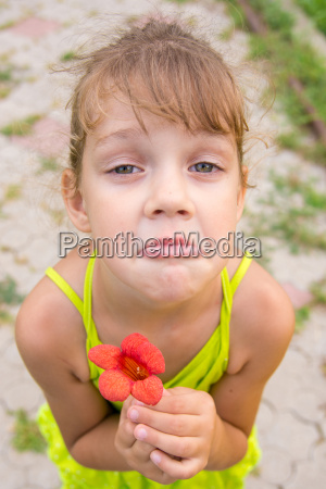 funny girl with a flower in