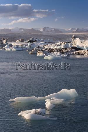 icebergs floating in the lagoon beneath