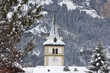 grindelwald village church after a heavy