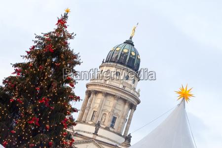 traditional christmas market at gendarmenmarkt illuminated