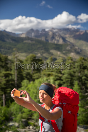 pretty young woman hiker taking a