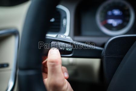 modern car interior driver pressing