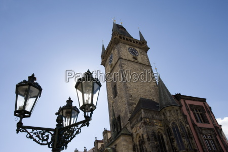 town hall clock tower and lamp