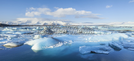 panorama of mountains and icebergs locked