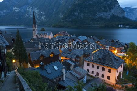 village of hallstatt illuminated at dusk
