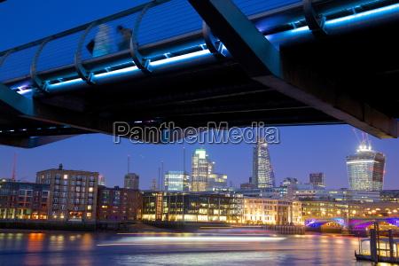 river thames millennium bridge and city