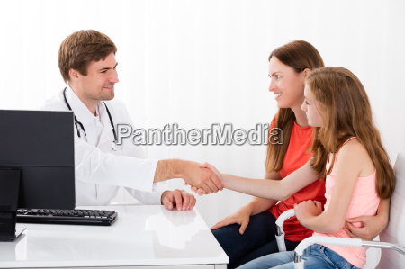 doctor shaking hand with child patient