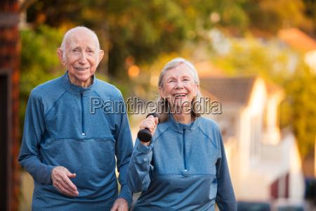 happy senior couple in athletic wear