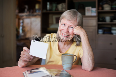 woman looking through photos in picture