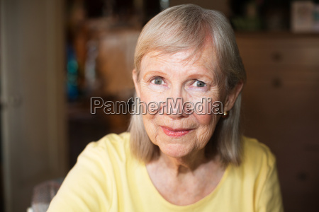 beautiful older woman with cheerful expression