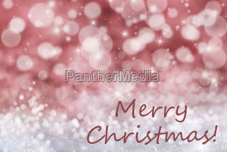 red bokeh background snow text merry
